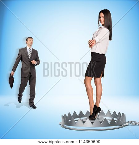Businessman with lady in bear trap