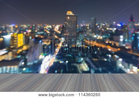 Opening wooden floor, abstract blurred bokeh city downtown aerial view