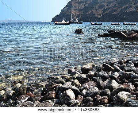 black rocks at Santorini beach Greece