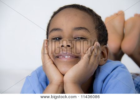 Young Kid With His Face Resting On His Hands