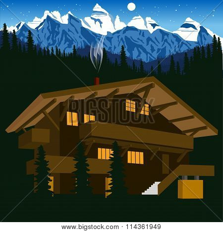 wooden chalet in mountain alps at night
