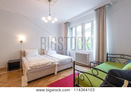 Hotel Room Interior With Double Bed