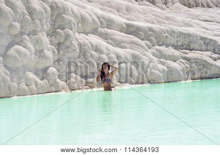 Woman Sitting In Travertine Pool In Pamukkale, Turkey