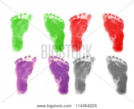 Set of infant 's footprints in four colors