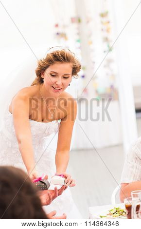 Bride  gives a gift for guests
