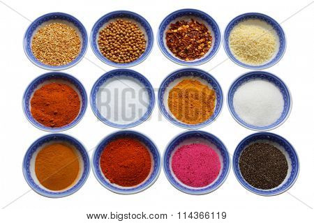 Variety of colorful spices in nine bowls