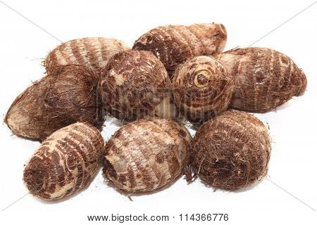 Group of taro root potatoes isolated on white