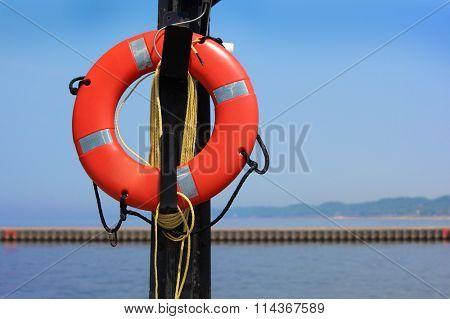 Buoyant foam lifesaving ring by the lakeshore
