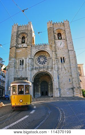 Lisbon Cathedral And Yellow Tram
