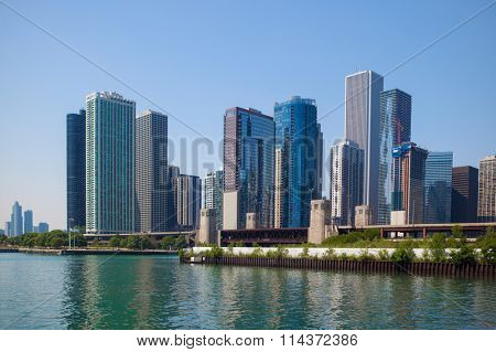 Buildings in Chicago with blue sky and turquoise river