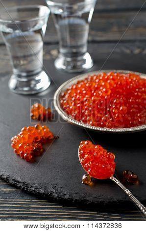 Red Salmon Caviar On Black Background