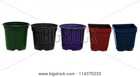 Row of empty flower plant pots in different shapes and colors