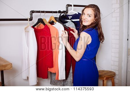 Beautiful Woman Chooses Clothes In The Wardrobe Closet