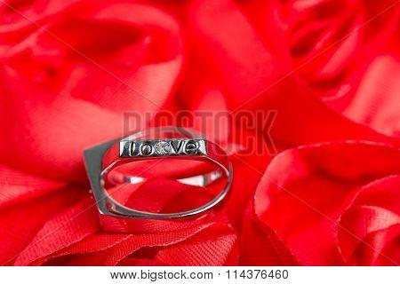 wedding rings on red