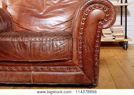 Closeup Texture Of Vintage Brown Leather Armchair In  Library