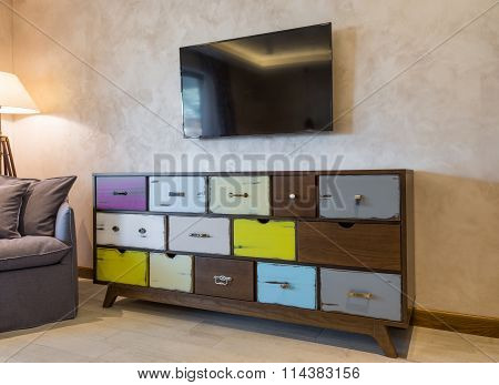 Shabby chic style commode in modern home interior