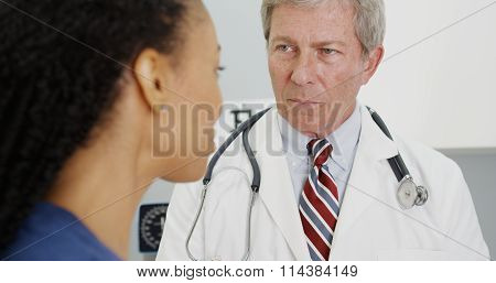 Black Woman Patient Talking To Her Doctor