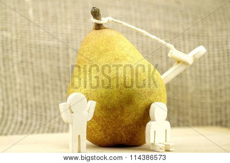 Pear with wooden figures