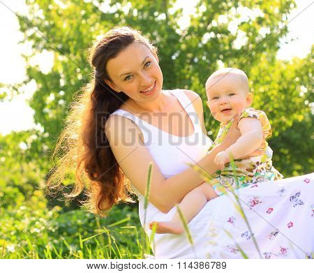 Beautiful Mother And Baby outdoors.