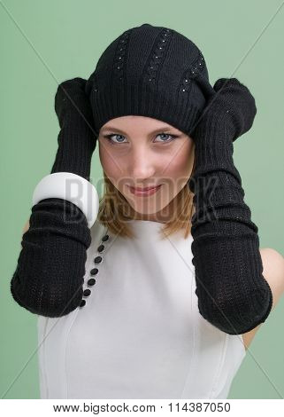 knitwear. young woman wearing a winter cap