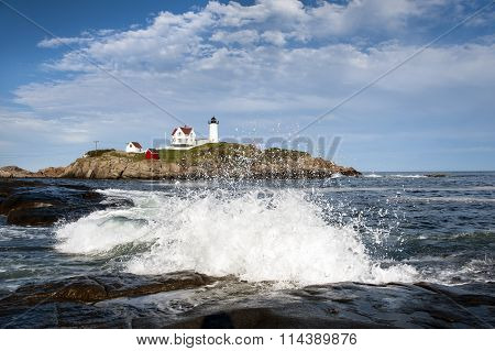 Waves Crashing On Rocks By Lighthouse In Maine