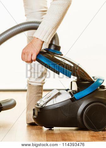 Woman Opening Vacuum Cleaner.
