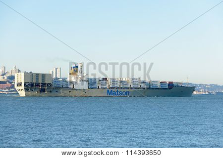 San Francisco, CA - December 31, 2015: A Matson container ship the Matsonia, leaving San Francisco the morning of December 31, 2015.