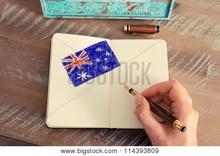Woman Hand Drawing The Australian Flag On Notebook