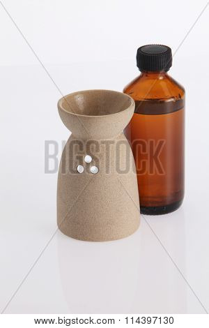 aromatheraphy oil with burner on the white background