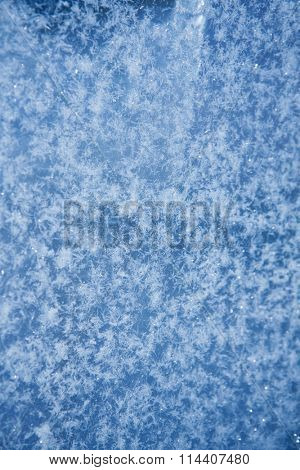 Winter ice frost, frozen background. frosted window glass texture. Cold cool icicles background. Winter wonderland scene. Christmas fresh, New Year background