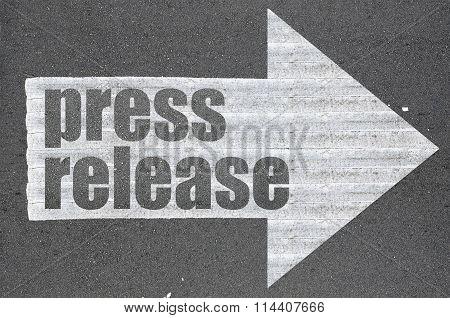 Arrow On Asphalt Road Written Word Press Release