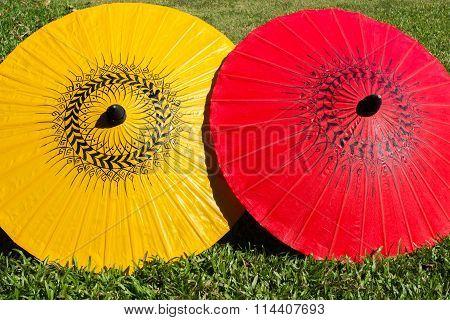Colorful umbrellas on grass field