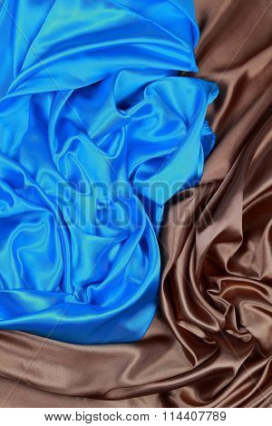 Blue And Brown Silk Satin Cloth Of Wavy Folds Texture Background