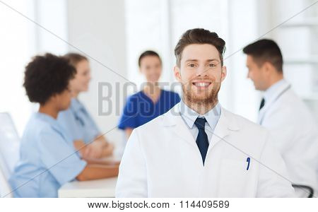 happy doctor over group of medics at hospital