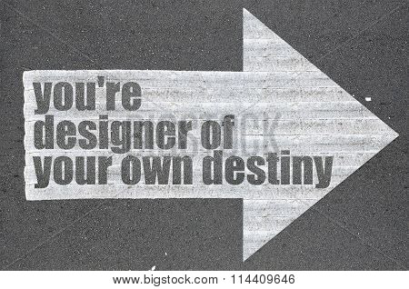 Arrow On Asphalt Road Written Word You're Designer Of Your Own Destiny