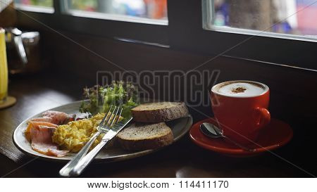 Breakfast Meal With A Cup Of Cappuccino In The Soft Light Mood With A Little Blurry