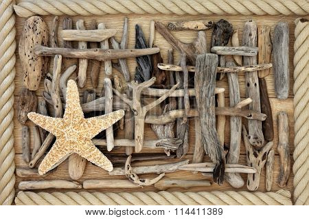 Driftwood and starfish abstract background over oak wood with rope surround.