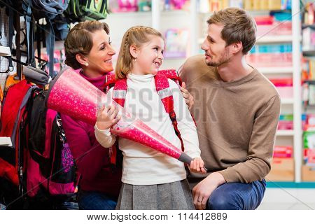 Family buying first day in school candy cone choosing from the available variety