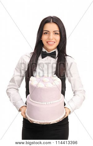 Vertical shot of a young waitress carrying a birthday cake isolated on white background
