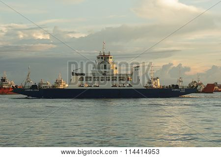 LABUAN FT, MALAYSIA - DEC 18, 2015: Ferry with vehicles on board in the evening on Dec 18, 2015.