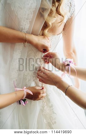 Beautiful Bride Getting Prepared With Bridesmaids On The Background Of A Room