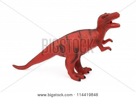 Red Tyrannosaurus Toy On A White Background