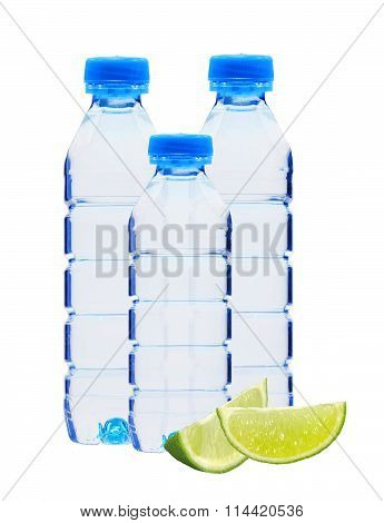 Blue Bottles With Water And Lime Slices Isolated On White