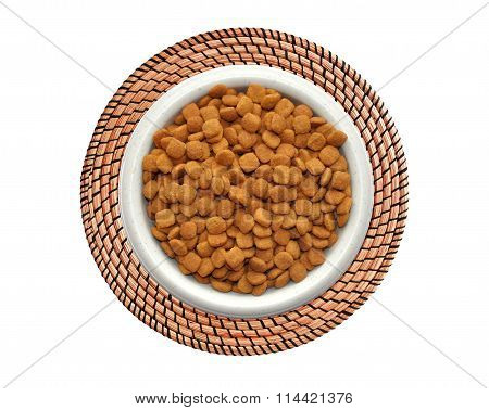 Dry Cat Food In Plate On Wicker Placemat Isolated On White Background