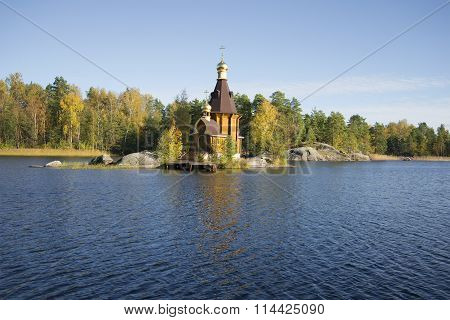 The river Vuoksi and the Church of St. Andrew October afternoon. Leningrad region, Russia