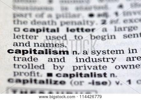 Closeup of the dictionary details of the word capitalism
