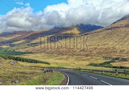 long road between mountains in Scotland
