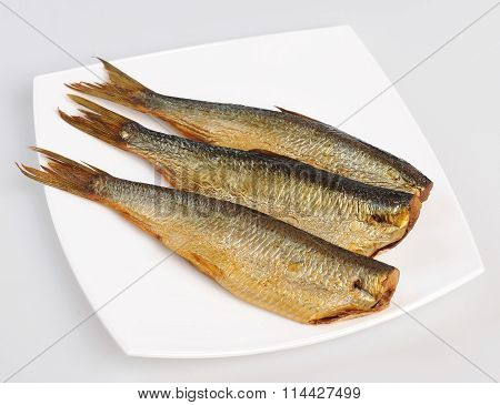 Whole fresh steamed and smoked mackerel fish isolated on white background