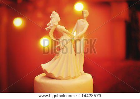 Figurine Of Newlyweds Background Yellow Light