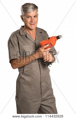 A Smiling Man Holding A Hammer Drill And Looking At Us.